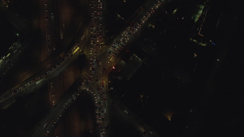 6K stock footage aerial video of a bird's eye of I-405 and SW Broadway at night, Downtown Portland, Oregon Aerial Stock Footage | AX155_341
