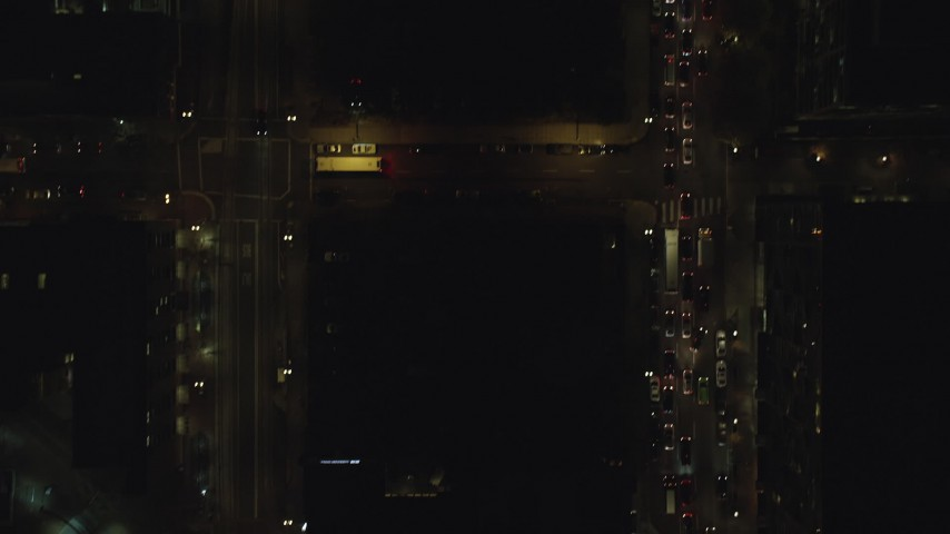 6K stock footage aerial video of a bird's eye of heavy traffic on downtown city streets at night, Downtown Portland, Oregon Aerial Stock Footage | AX155_343