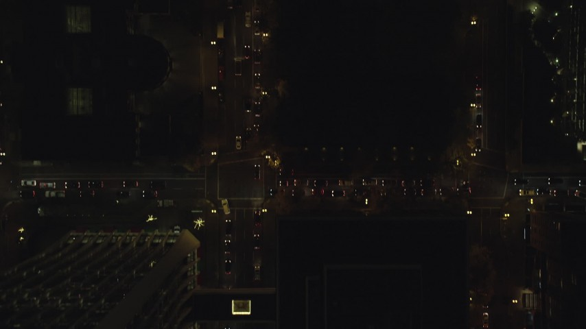 6K stock footage aerial video of a bird's eye of following SW 4th Avenue through downtown at night, Downtown Portland, Oregon Aerial Stock Footage | AX155_344