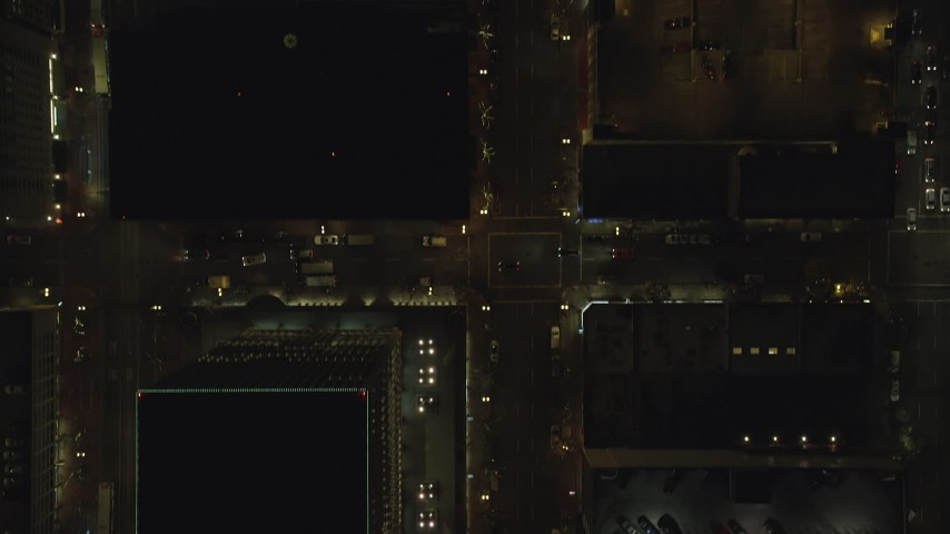 6K stock footage aerial video of a bird's eye of following SW 4th Avenue through downtown at night, and reveal Pioneer Place Downtown Portland, Oregon Aerial Stock Footage | AX155_345