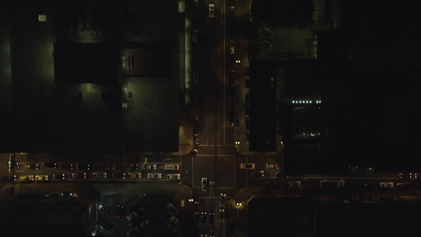 6K stock footage aerial video of a bird's eye of SW Broadway at night in Downtown Portland, Oregon, reveal construction site Aerial Stock Footage | AX155_356
