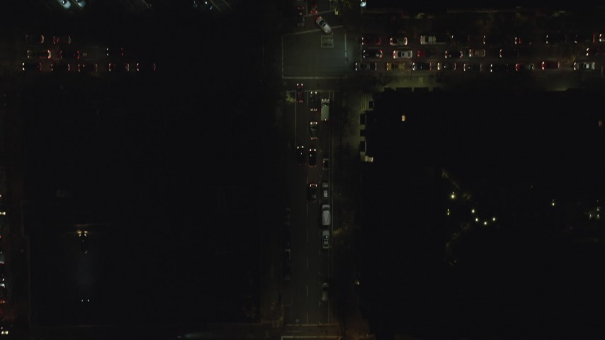 6K stock footage aerial video of a bird's eye view of SW Broadway at night in Downtown Portland, Oregon Aerial Stock Footage | AX155_357