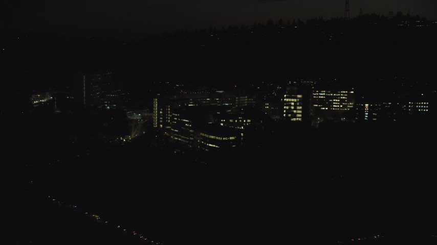 6K stock footage aerial video flying by and away from the Oregon Health and Science University at night in Portland, Oregon Aerial Stock Footage | AX155_358