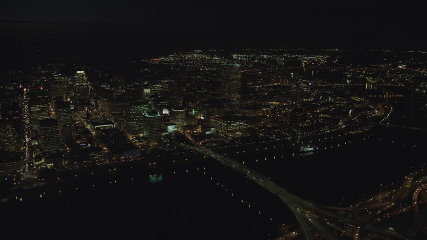 6K stock footage aerial video of Downtown Portland, the Morrison Bridge and the Burnside Bridge over Willamette River, night, Oregon Aerial Stock Footage | AX155_360