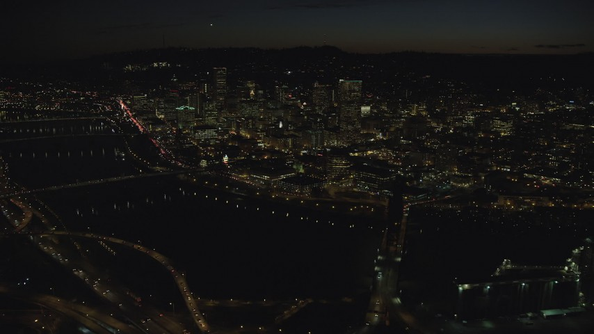 6K stock footage aerial video of Downtown skyscrapers and bridges over the Willamette River at nighttime, Downtown Portland, Oregon Aerial Stock Footage | AX155_363