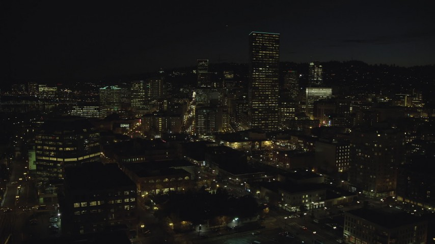 6K stock footage aerial video of US Bancorp Tower at nighttime seen from One Pacific Square, Downtown Portland, Oregon Aerial Stock Footage | AX155_367