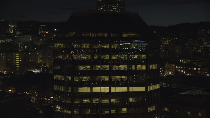 6K stock footage aerial video flying by One Pacific Square at night, Downtown Portland, Oregon Aerial Stock Footage | AX155_369