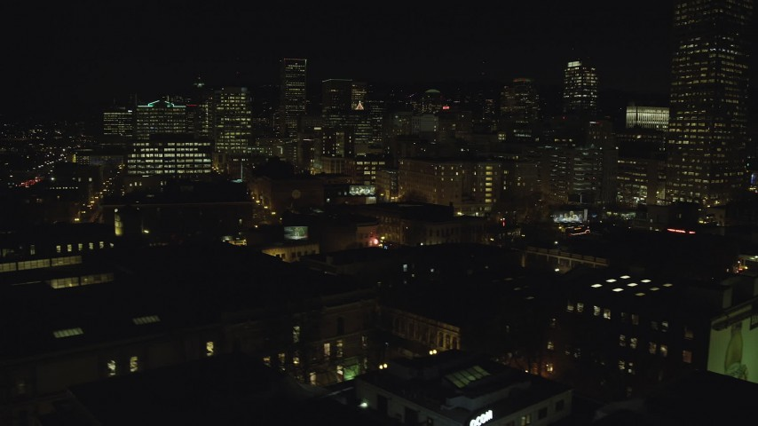6K stock footage aerial video of Downtown Portland at night, and reveal the White Stag sign, Oregon Aerial Stock Footage | AX155_370