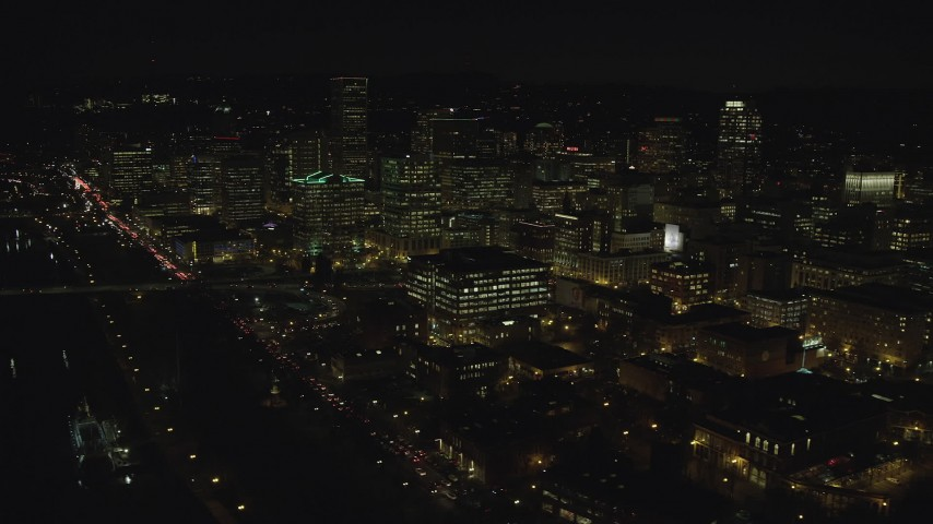 6K stock footage aerial video of Downtown Portland and the Morrison Bridge at night, Oregon Aerial Stock Footage | AX155_371