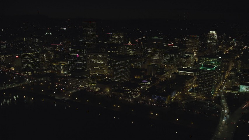 6K stock footage aerial video of Downtown Portland high-rises seen from near the Hawthorne Bridge at night, Oregon Aerial Stock Footage | AX155_373