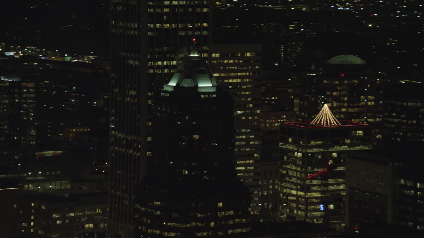6K stock footage aerial video of KOIN Center rooftop venting steam at night in Downtown Portland, Oregon Aerial Stock Footage | AX155_375