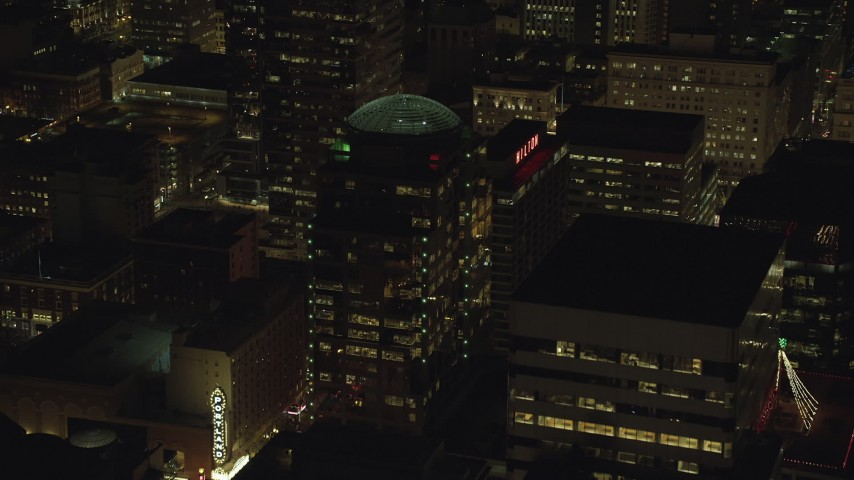 Approach 1000 Broadway building and Hilton Portland at night in Downtown Portland, Oregon Aerial Stock Footage | AX155_378