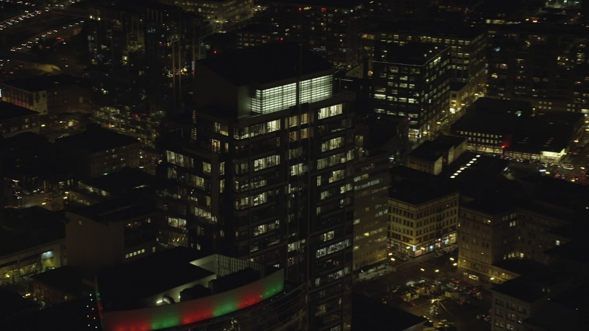 6K stock footage aerial video flying by and away from Park Avenue West Tower at night in Downtown Portland, Oregon Aerial Stock Footage | AX155_379