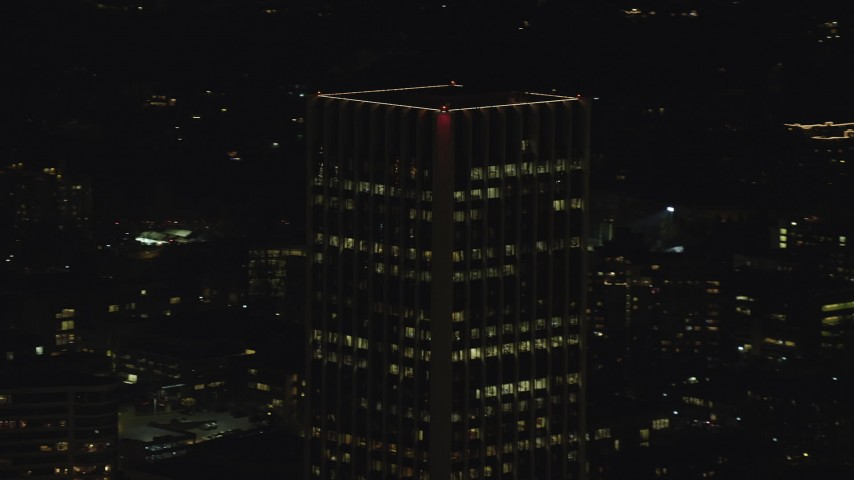 6K stock footage aerial video orbiting the top of Wells Fargo Center at night in Downtown Portland, Oregon Aerial Stock Footage | AX155_380