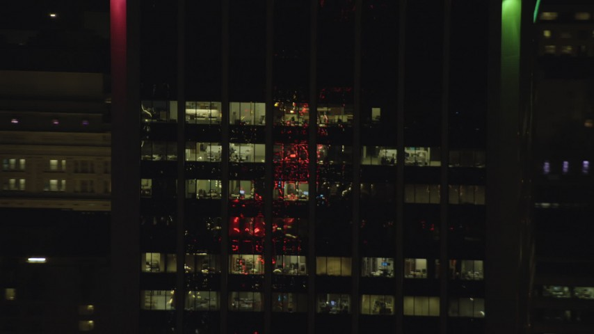 6K stock footage aerial video tracking offices on the top floors of Wells Fargo Center at night in Downtown Portland, Oregon Aerial Stock Footage | AX155_382