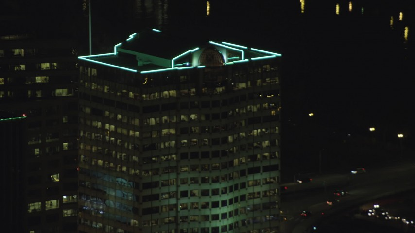 6K stock footage aerial video tracking Bank of America Financial Center at night in Downtown Portland, Oregon Aerial Stock Footage | AX155_383