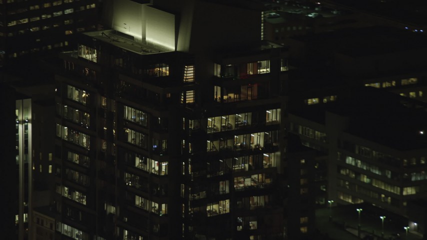 6K stock footage aerial video of offices on top floors of Park Avenue West Tower at night in Downtown Portland, Oregon Aerial Stock Footage | AX155_384