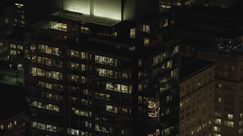 6K stock footage aerial video of the top floors of Park Avenue West Tower at night in Downtown Portland, Oregon Aerial Stock Footage | AX155_385