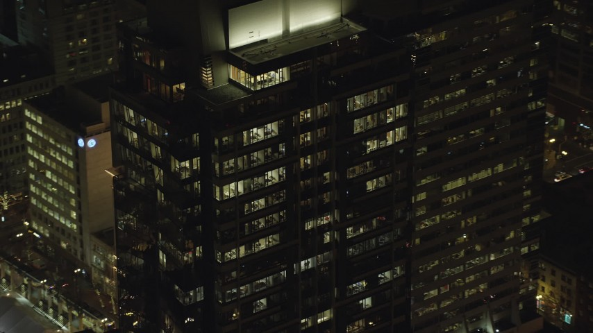6K stock footage aerial video orbiting the top floors of Park Avenue West Tower at night in Downtown Portland, Oregon Aerial Stock Footage | AX155_386