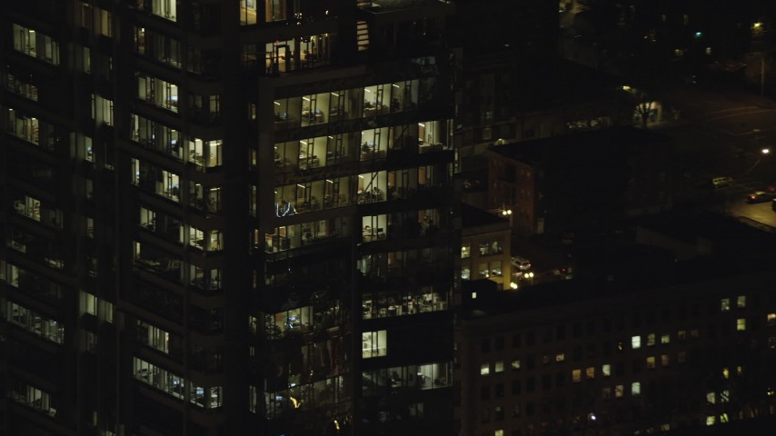 6K stock footage aerial video orbiting the top floors of Park Avenue West Tower at nighttime in Downtown Portland, Oregon Aerial Stock Footage | AX155_387