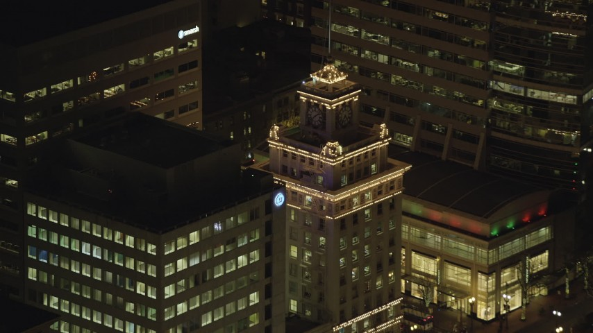6K stock footage aerial video orbiting top of Jackson Tower at nighttime in Downtown Portland, Oregon, reveal and track a drone Aerial Stock Footage | AX155_388