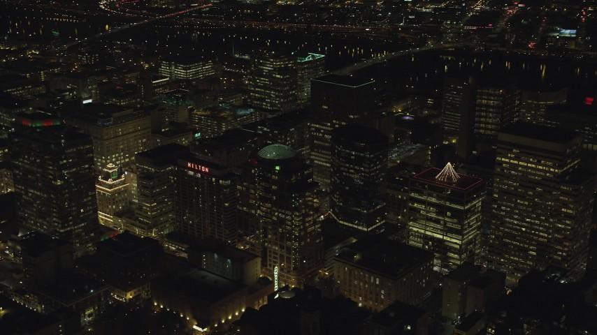 6K stock footage aerial video of high-rises and skyscrapers by the Willamette River at night in Downtown Portland, Oregon Aerial Stock Footage | AX155_391