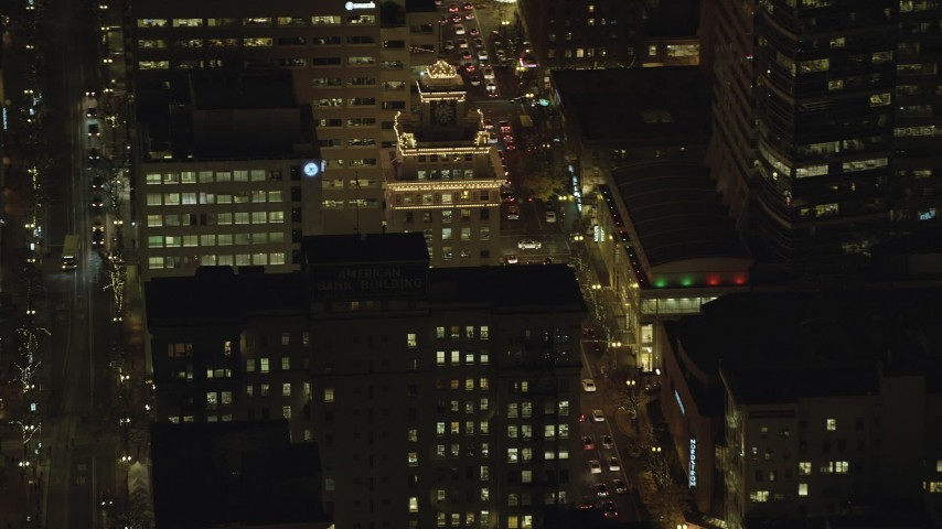 6K stock footage aerial video flying by Jackson Tower at night in Downtown Portland, Oregon Aerial Stock Footage | AX155_395