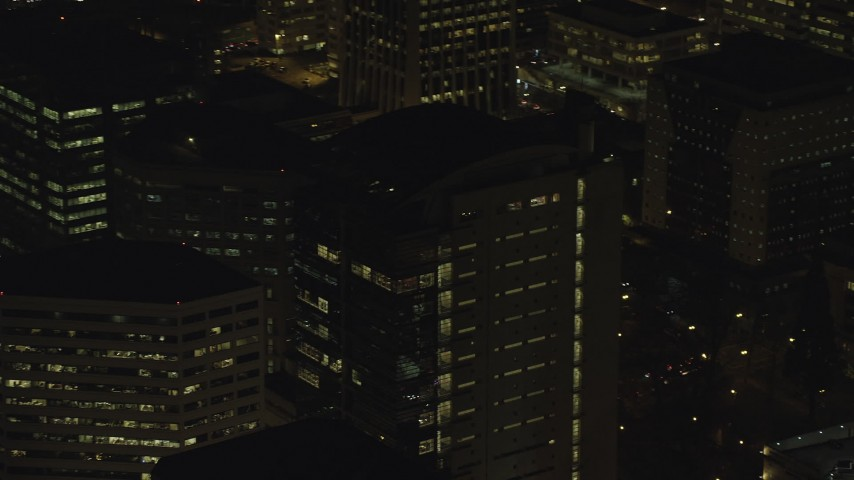 6K stock footage aerial video orbiting the dark upper floors of an office building at night in Downtown Portland, Oregon Aerial Stock Footage | AX155_396