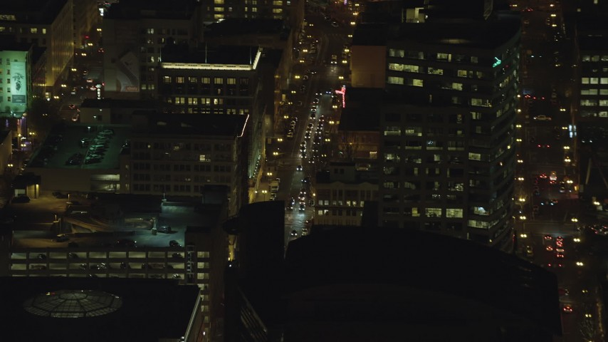 6K stock footage aerial video of city traffic on SW 3rd Avenue at nighttime in Downtown Portland, Oregon Aerial Stock Footage | AX155_398