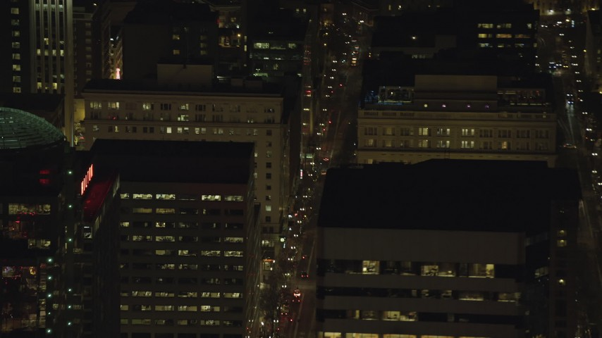 6K stock footage aerial video of SW Broadway through downtown at nighttime in Downtown Portland, Oregon Aerial Stock Footage | AX155_399