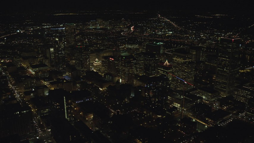 6K stock footage aerial video passing downtown high-rises and skyscrapers at nighttime in Downtown Portland, Oregon Aerial Stock Footage | AX155_400