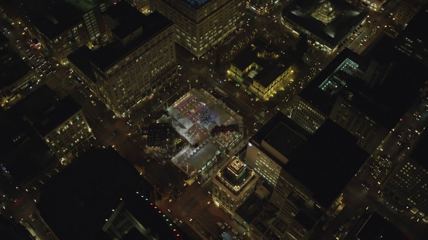 6K stock footage aerial video orbiting and flying away from Christmas tree in Pioneer Courthouse Square at night in Downtown Portland, Oregon Aerial Stock Footage | AX155_404