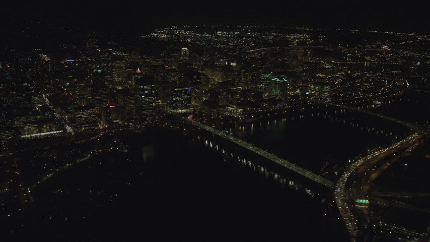 6K stock footage aerial video flying by and approaching Downtown Portland from the Hawthorne Bridge at night, Oregon Aerial Stock Footage | AX155_406