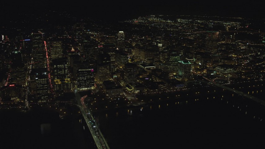 6K stock footage aerial video approaching Downtown Portland from the Willamette River at night in Oregon Aerial Stock Footage | AX155_407
