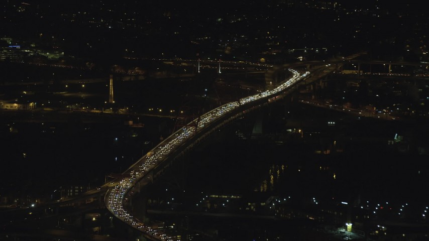 6K stock footage aerial video of heavy traffic congestion on the Fremont Bridge at night in Downtown Portland, Oregon Aerial Stock Footage | AX155_411