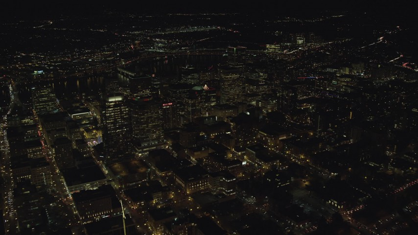 6K stock footage aerial video approaching high-rises and skyscrapers at night in Downtown Portland, Oregon Aerial Stock Footage | AX155_413