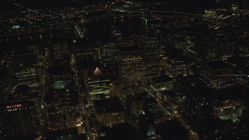 6K stock footage aerial video flying by PacWest Center, SW Jefferson Street, and Wells Fargo Center at night in Downtown Portland, Oregon Aerial Stock Footage   AX155_414