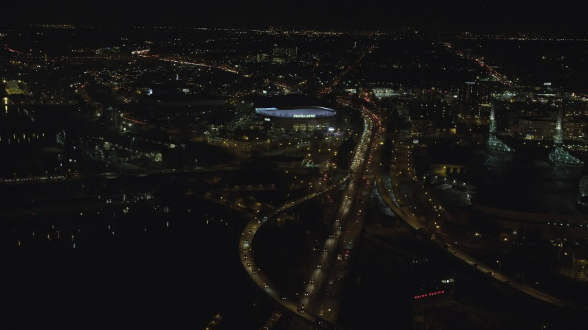 6K stock footage aerial video following I-5 to approach Moda Center at night in Northeast Portland, Oregon Aerial Stock Footage | AX155_421