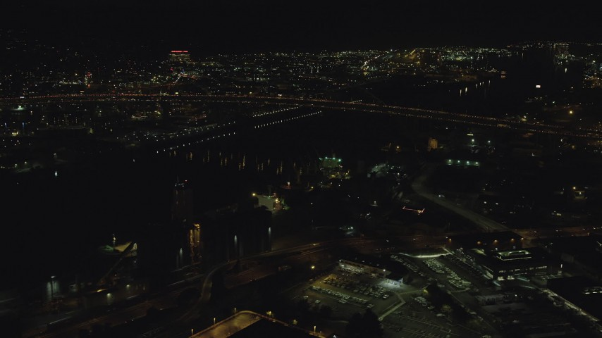 6K stock footage aerial video approaching the Fremont Bridge with heavy traffic on both decks, Downtown Portland, Oregon Aerial Stock Footage AX155_423   Axiom Images