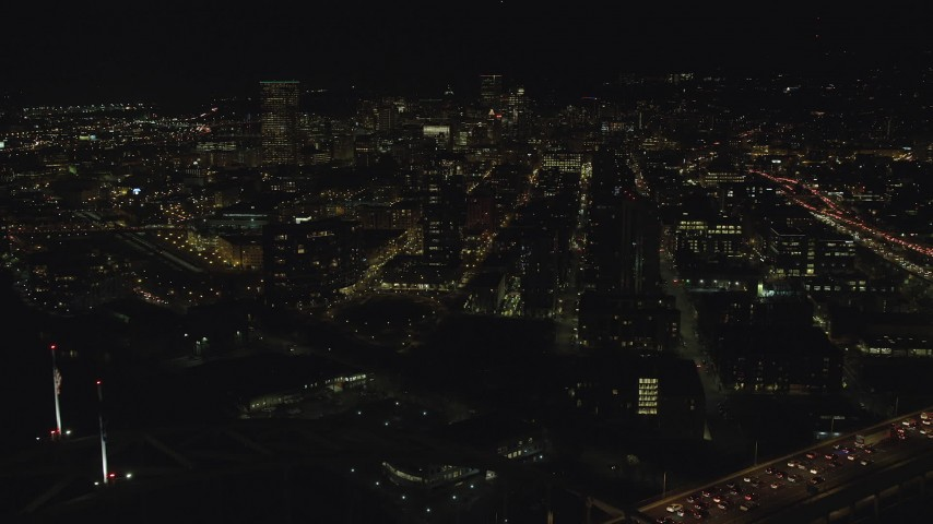 6K stock footage aerial video of Downtown Portland, Oregon at night from the Fremont Bridge Aerial Stock Footage | AX155_427