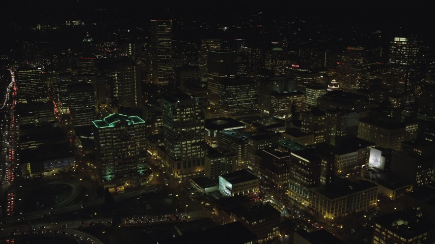 6K stock footage aerial video flying over Downtown Portland, Oregon at night, approach Standard Insurance Center Aerial Stock Footage | AX155_433