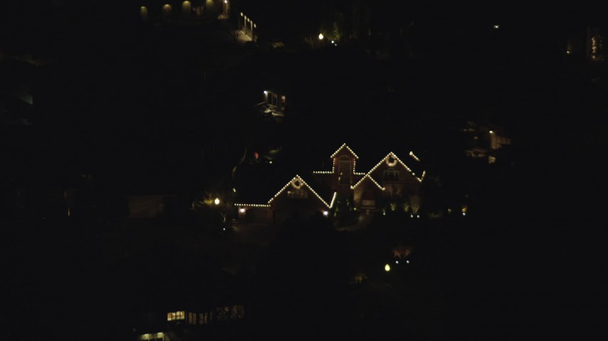 6K stock footage aerial video approaching a suburban home at night decorated for Christmas, Southwest Portland, Oregon Aerial Stock Footage   AX155_442
