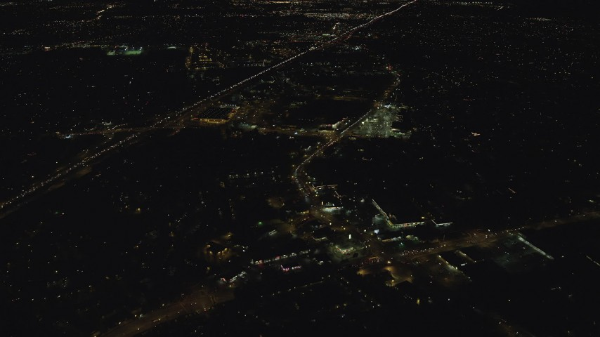 6K stock footage aerial video approaching strip malls by Highway 26 at night, Beaverton, Oregon Aerial Stock Footage   AX155_446