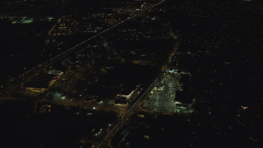6K stock footage aerial video flying over strip mall by Highway 26 at night to approach neighborhood, Beaverton, Oregon Aerial Stock Footage | AX155_447