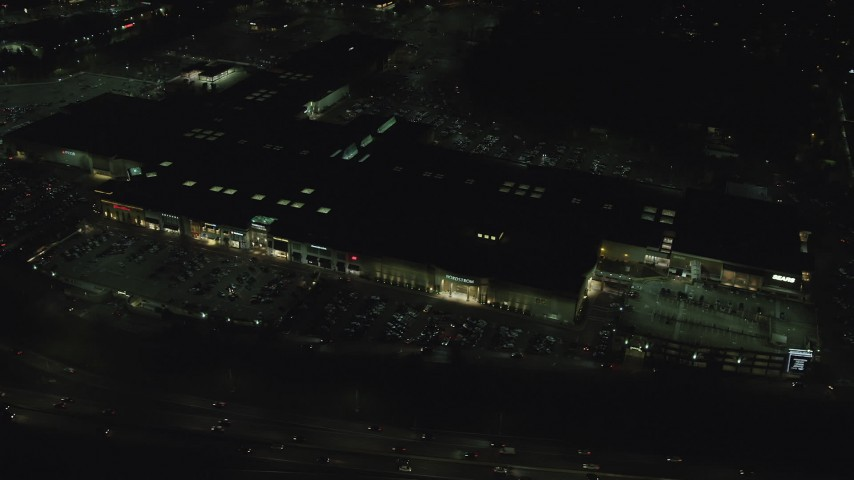6K stock footage aerial video orbiting the Washington Square shopping mall at night in Tigard, Oregon Aerial Stock Footage | AX155_452