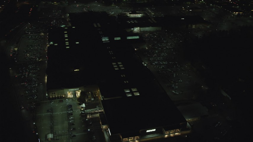 6K stock footage aerial video orbiting the Washington Square shopping mall at night in Tigard, Oregon Aerial Stock Footage | AX155_453