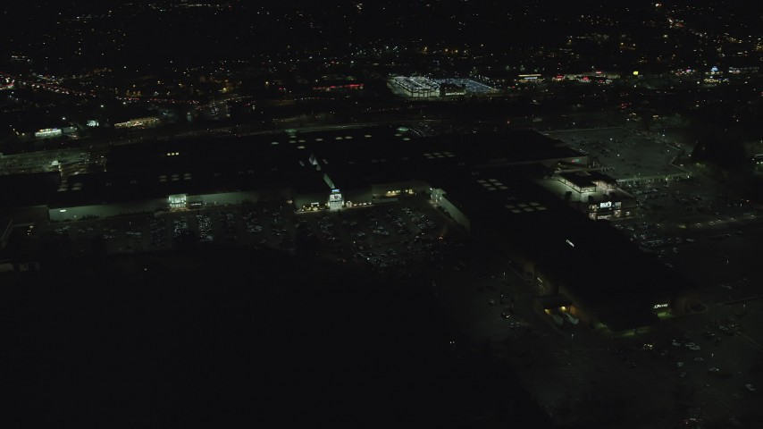 6K stock footage aerial video orbiting side of Washington Square mall at night in Tigard, Oregon Aerial Stock Footage | AX155_455