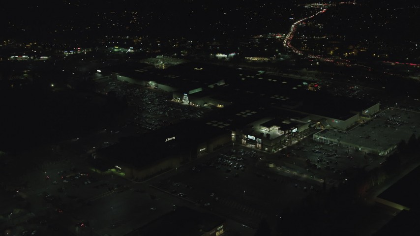 6K stock footage aerial video orbiting the side of Washington Square mall at nighttime in Tigard, Oregon Aerial Stock Footage | AX155_456