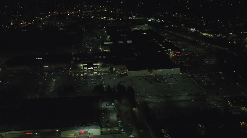 6K stock footage aerial video orbiting around the side of Washington Square mall at nighttime in Tigard, Oregon Aerial Stock Footage | AX155_457