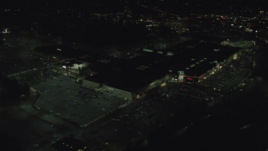 6K stock footage aerial video orbiting around Washington Square mall at nighttime in Tigard, Oregon Aerial Stock Footage | AX155_458